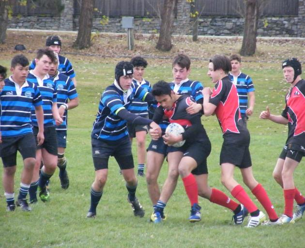 Twizel (red) and Maniototo 1st XVs engaged in a highly physical encounter.