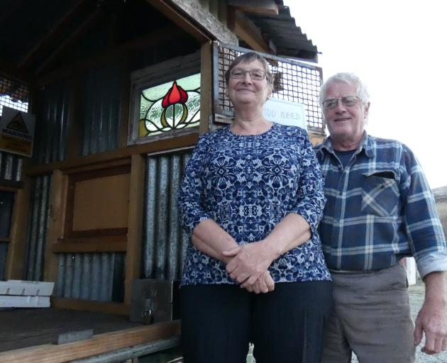 Melanie and Maurice Hillier show the honesty box on the floor of their roadside cabin that was nearly purloined by a would-be thief. Photos: Simon Henderson