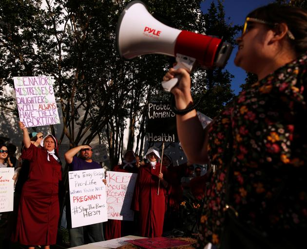 Pro-choice supporters protest in front of the Alabama State House. Photo: Reuters
