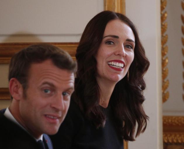 New Zealand Prime Minister Jacinda Ardern, right, and French President Emmanuel Macron, arrive...