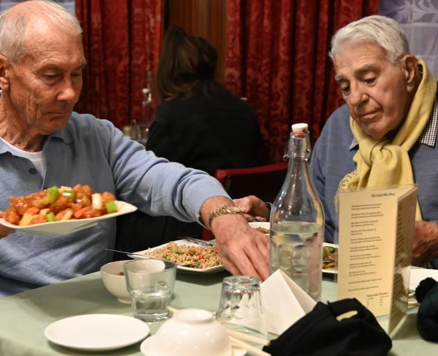 Enjoying a last meal at the Asian after years of patronage are Bill Menlove (left) and Bernard...