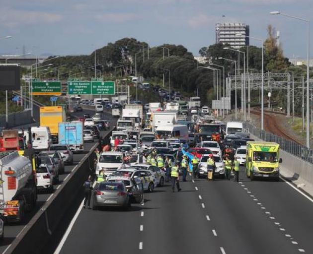 One person dead after fall from vehicle on Auckland Motorway