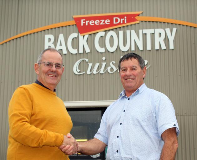 Marking the sale of Back Country Foods to Invercargill family business George Wilson Group are Back Country Foods general manager John McGrath (left) and Murray Wilson, owner of George Wilson Group, in Invercargill yesterday. Photo: Laura Smith