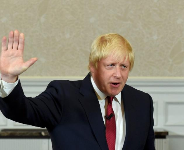 Boris Johnson waves as he finishes delivering a speech in London. Photo: Reuters