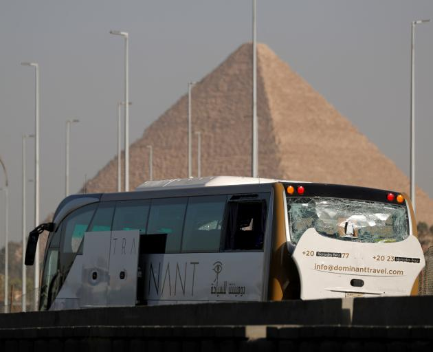 A damaged bus is seen at the site of a blast near a new museum being built close to the Giza pyramids in Cairo. Photo: Reuters