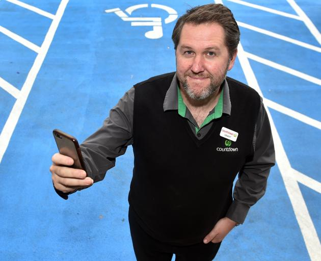Countdown Dunedin South manager Grant McEwan tests the new Access Aware app on a freshly-painted...