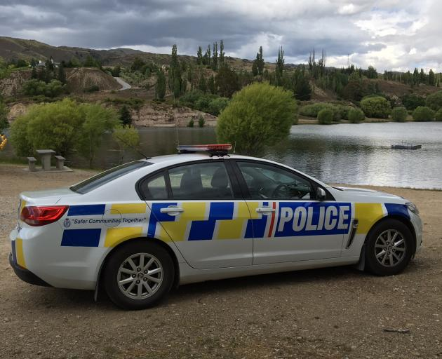 Police at the Bannockburn inlet. Photo: Jono Edwards