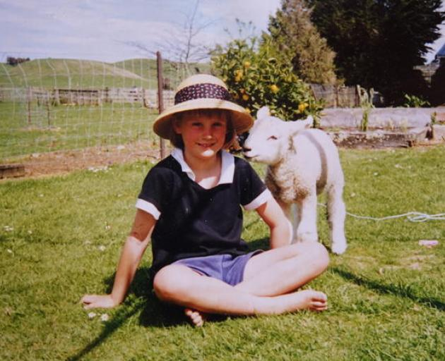 Busby as a lamb with four-year-old Olivia. Photo: Supplied