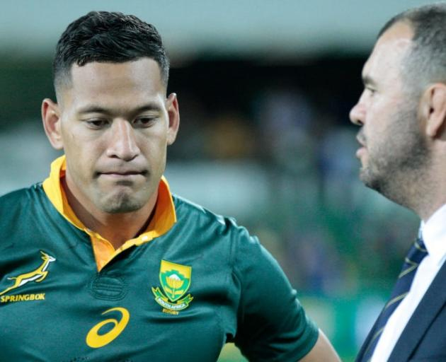 Israel Folau, pictured wearing a Springboks jersey, with coach Michael Cheika. Photo: Getty Images