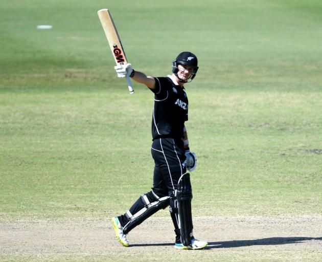 Will Young celebrates scoring a century during the Cricket World Cup practice match between...