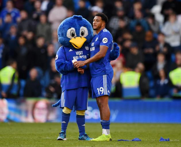 Cardiff City's Nathaniel Mendez-Laing is comforted by the club mascot following their relegation...