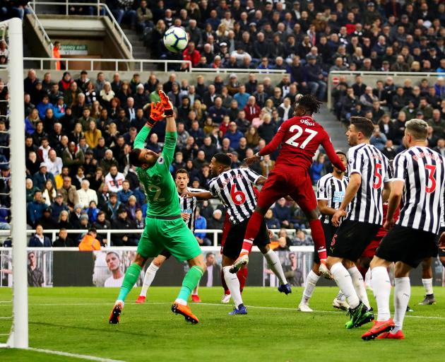 Liverpool's Divock Origi (no. 27) heads home a crucial late winner to take the Reds 2 points...