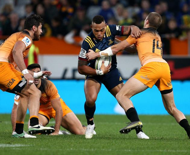 Tevita Li fights in the tackle during the Highlanders' close win over the Jaguares at Forsyth...