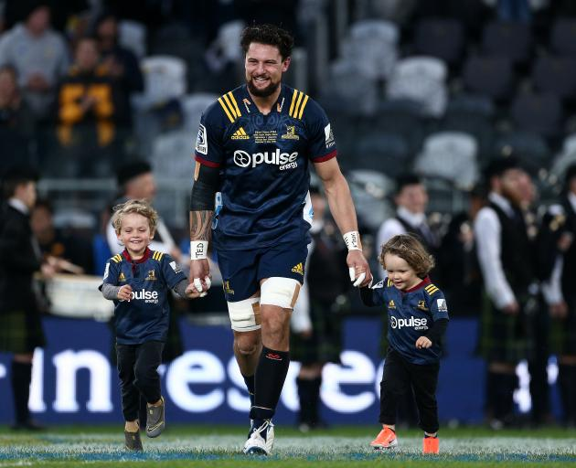 Elliot Dixon runs onto the field with his biggest fans for his 100th Super Rugby match for the...