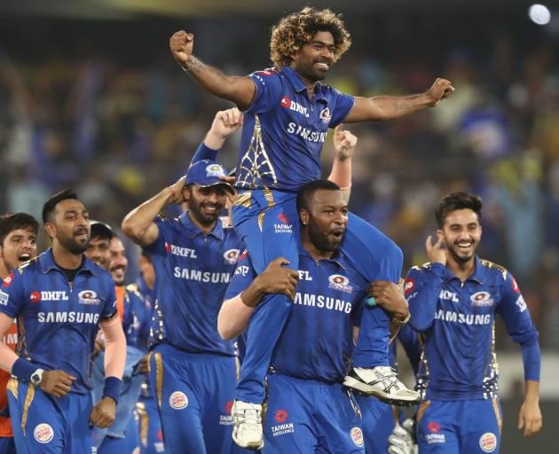 The Mumbai Indians celebrate after they defeated the Chennai Super Kings during the Indian...