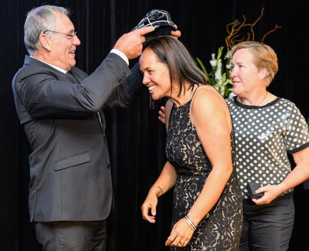 Former Otago player Maree Edwards receiving her Black Ferns cap from New Zealand Rugby president...