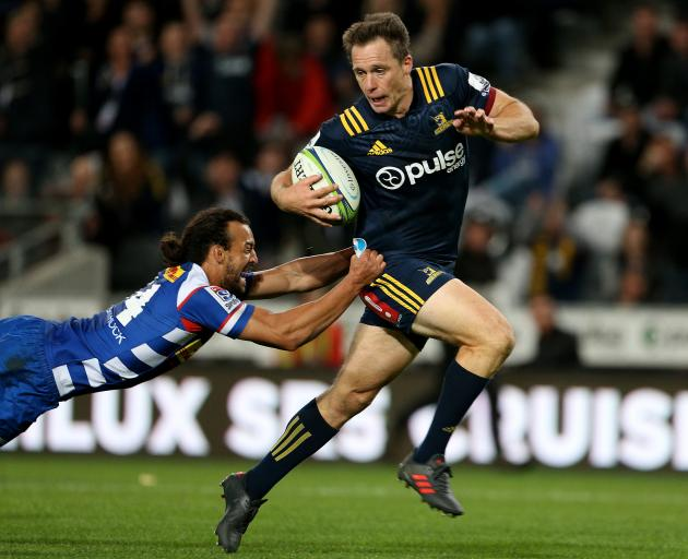 Highlanders fullback Ben Smith is tackled by Stormers winger Dillyn Leyds during the round four...