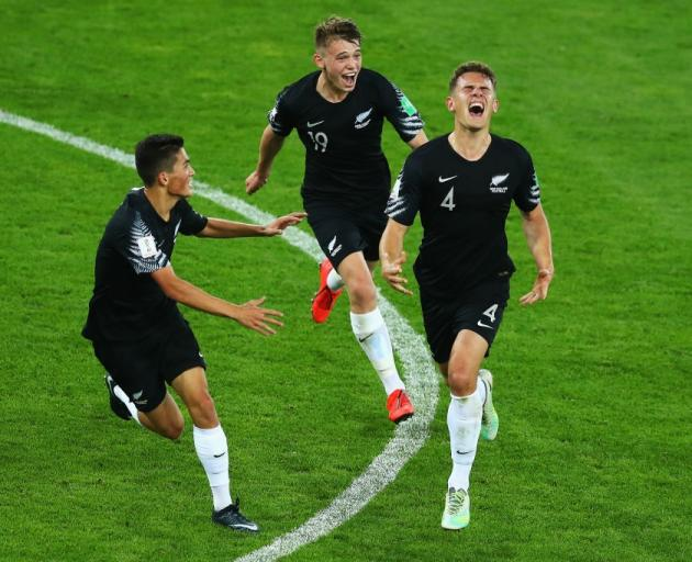 Gianni Stensness celebrates his goal against Norway this morning alongside Elijah Just and Callum...