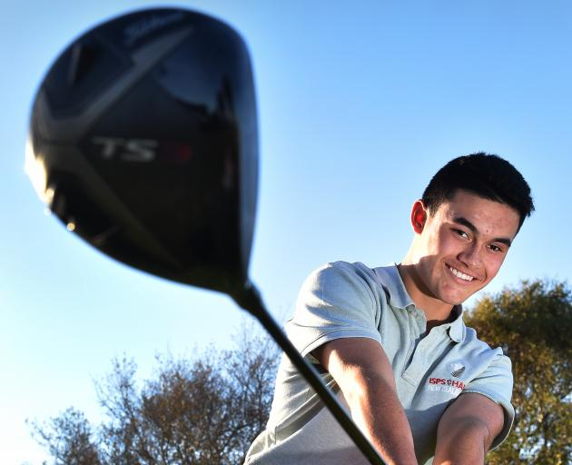 Young golfer Parker Aluesi at the St Clair Golf Club yesterday. Photo: Peter McIntosh