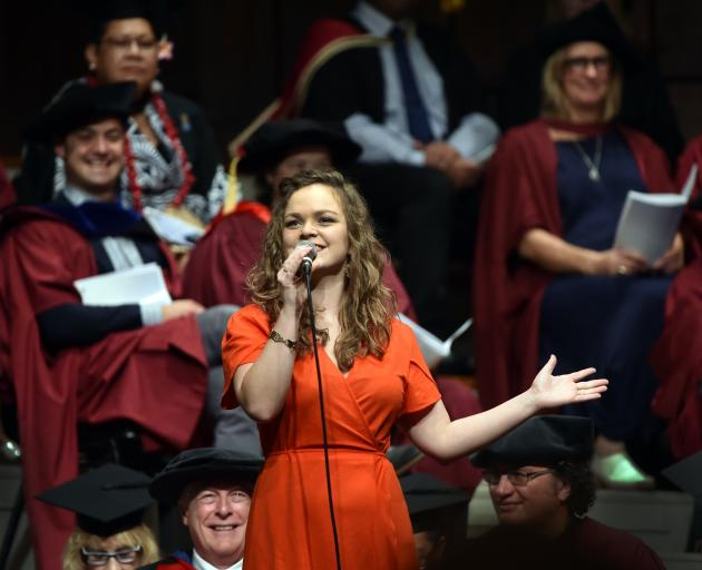 Vocalist Hannah Thompson-Holloway sings during the 1pm graduation ceremony.