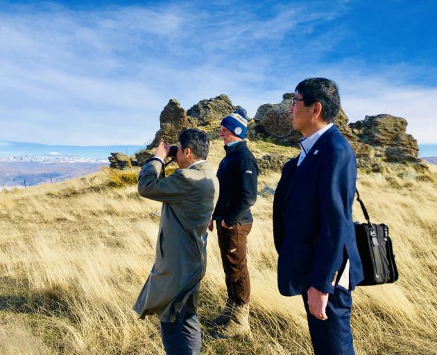 Checking out the scenery on Northburn, near Cromwell, are Nikke Group executives Takanobu Matsumoto (left) and Hiroyuki Kondou, with farm manager Ben Nielsen-Vold. Photo: New Zealand Merino Company