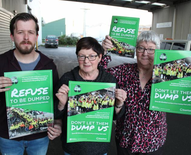 Save Southland disAbility Enterprises campaigners (from left) Tony Stewart, Lynda Mooij and Rae Burt will be spreading posters throughout Southland today as part of a campaign to keep a regional waste contract. Photo: Jono Edwards