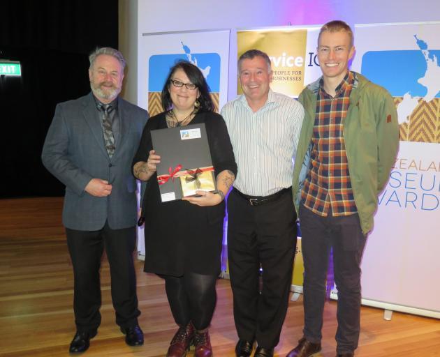 Arts Access Aotearoa executive director Richard Benge (left) at Te Papa last night with Dunedin award winners Rachel Wesley, Craig Grant and Kane Fleury. Photo: Supplied