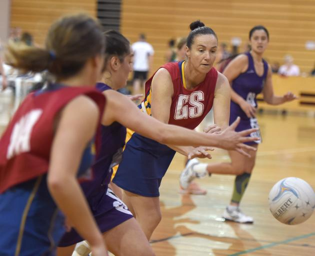 Jo Morrison bounces a pass down court during the Physed Blues game against South Pacific at the...