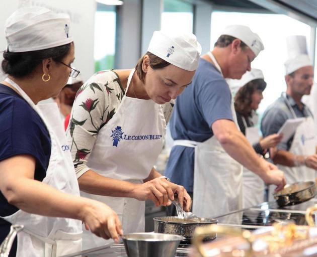 Having a go at the Cordon Bleu Cooking Academy. Photo: Tauck Inc