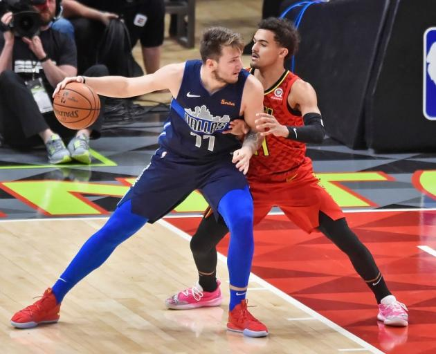 Luka Doncic (left) posts up Trae Young in a game in Atlanta during their NBA rookie season. Photo...