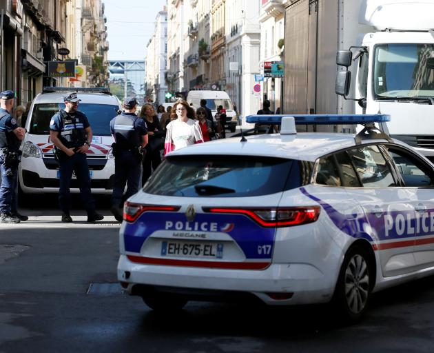 Police patrol the streets during the manhunt of a suspected suitcase bomber in central Lyon. Photo: Reuters