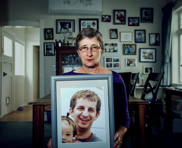 Martha Savage holding a photo of her son Kelly. Photo: RNZ