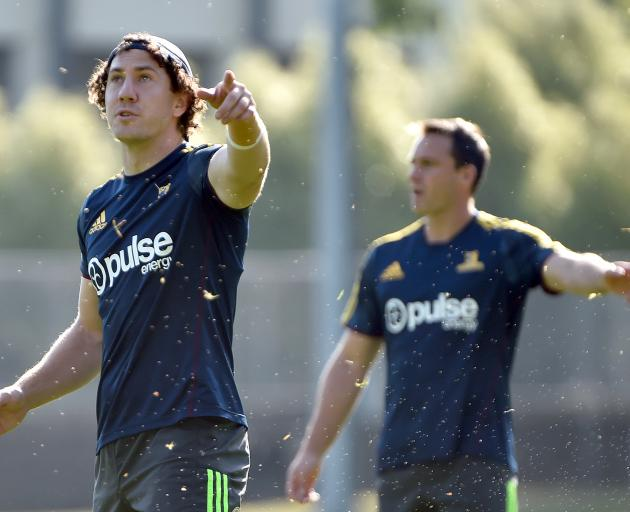 Marty Banks (front) and Ben Smith point the way forward at Highlanders training at Logan Park...