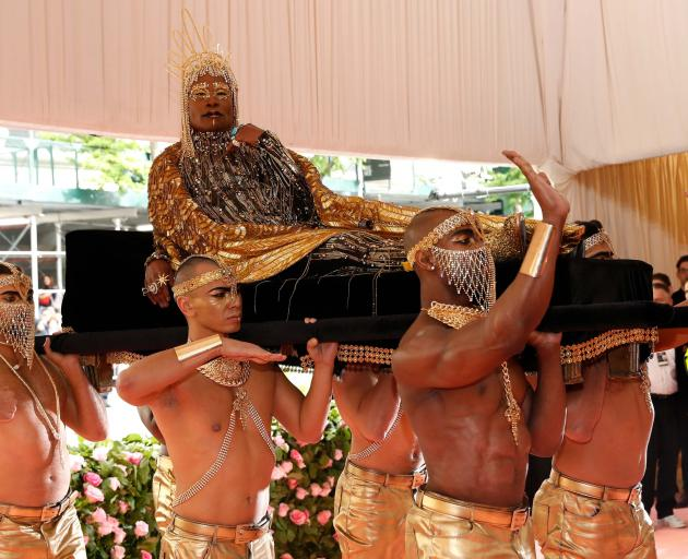 Performer Billy Porter, dressed in head-to-toe gold, summoned ancient Egypt when he was carried into the gala on a litter by six shirtless men. Photo: Reuters