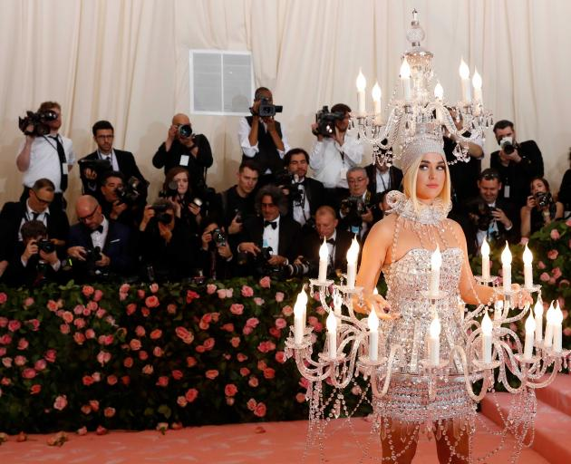 """""""Roar"""" singer Katy Perry came dressed as a chandelier, even wearing one on her head. Photo: Reuters"""