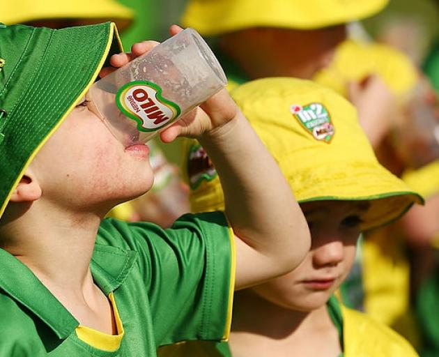 oung participants drink Milo during the launch for Cricket Australia's junior sports program MILO in2CRICKET  in Sydney. Photo: Getty Images