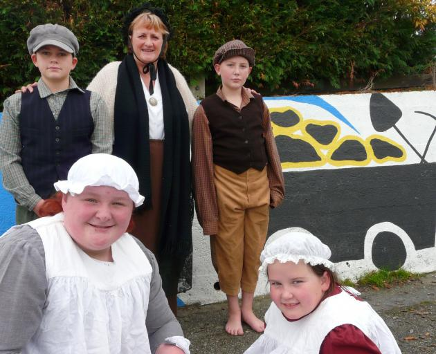 Kaitangata School members in this weekend's Blood on the Coal commemorative mining disaster play are (from left) Max Marshall (12), Jordan Atkin-Coutts (12), teacher Ruth Baldwin, Sladen Sutton (12) and Marareira Carroll (9). Photo: Richard Davison