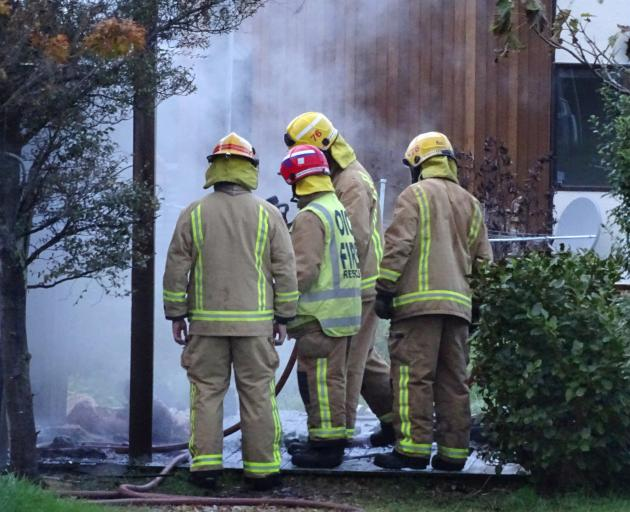 Fire crews responded quickly to a fire in a sleepout in Queenstown yesterday, but it could not be saved. Photos: Miranda Cook