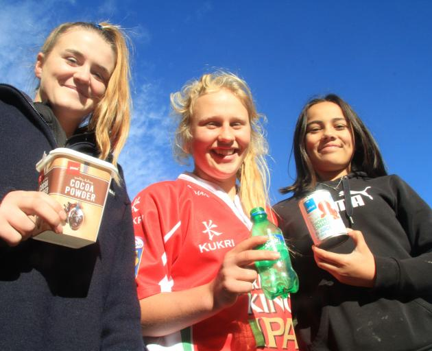 Showing a few items that should be recycled are East Otago High School year 9 pupils (from left) Sarah Hay, of Macraes Flat, Abigail Paton, of Dunback, and Shayla Raharaha-Baird, of Karitane, at the Waitaki Resource Recovery Park, in Oamaru, yesterday. Ph