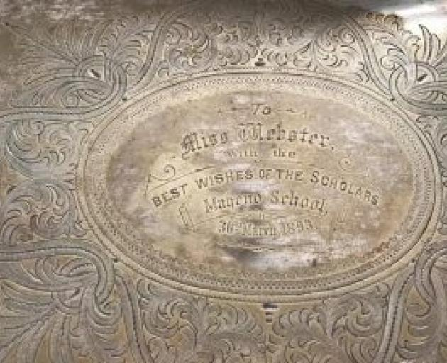 "The tray is engraved: ""to Miss Webster, with the best wishes of the scholars, Maheno School""."