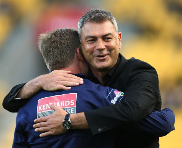 he Phoenix's old coach Mark Rudan hugs new coach Ufuk Talay. Photo: Getty Images.