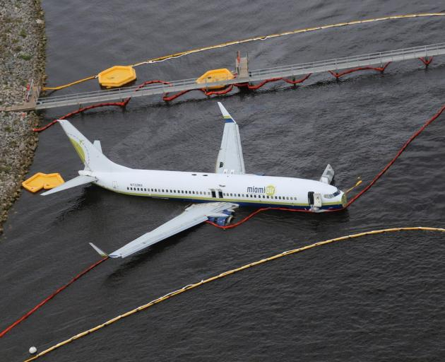 Aerial view of the Miami Air International Boeing 737-800 that overran the runway at NAS Jacksonville. Photo:  NTSB/Handout via Reuters