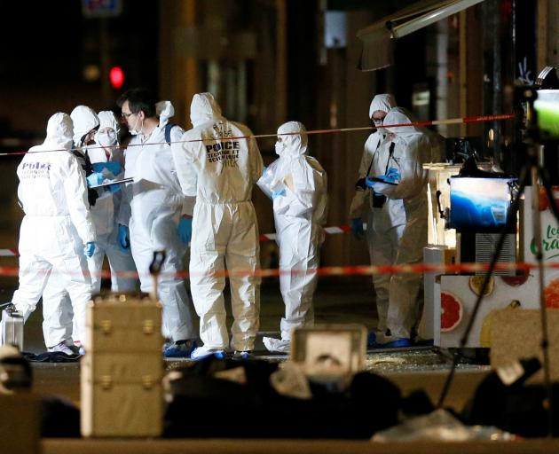 French police were hunting a suspected suitcase bomber on Friday after an explosion in the central city of Lyon that injured 13 people, officials said. Photo: Reuters