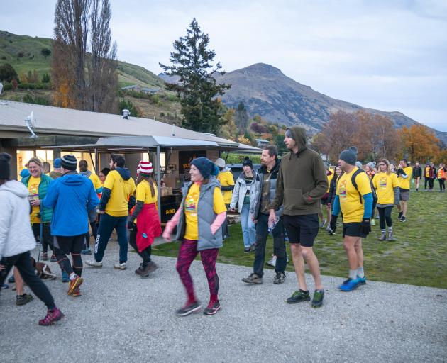 Participants in the ``Darkness Into Light'' walk arrive back at the Lake Hayes Pavilion near...