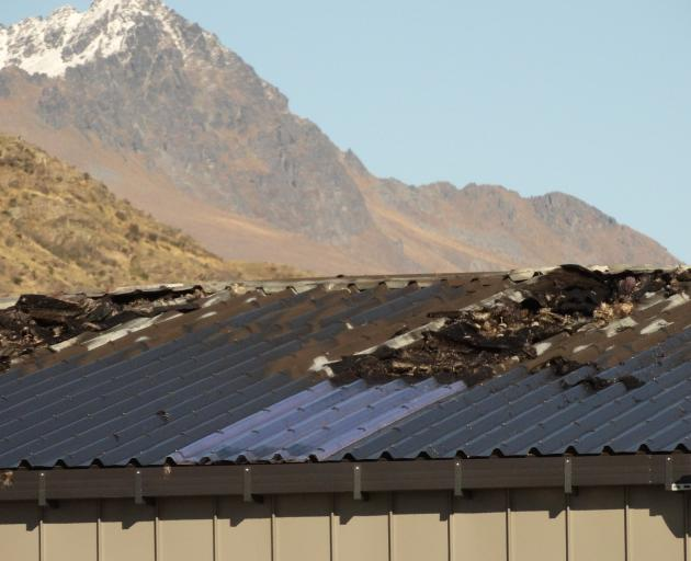 The fire-damaged roof at Macaulay Motors in Queenstown. Photo: Guy Williams