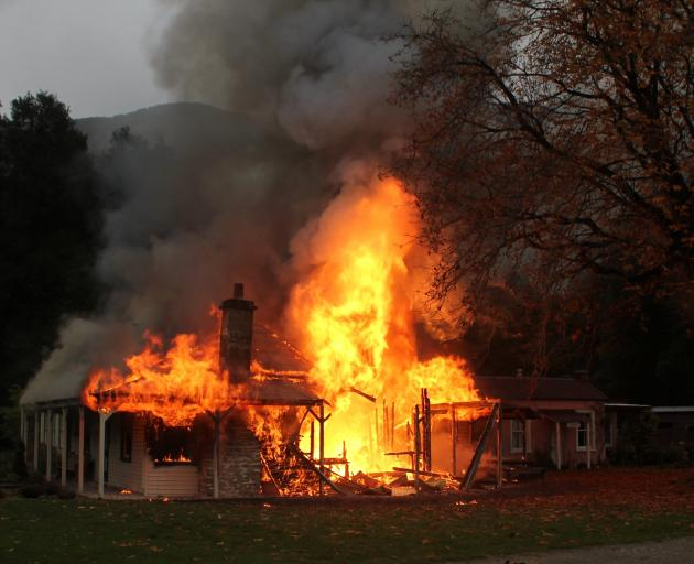 The 133-year-old homestead on fire. PHOTO: PARADISE TRUST