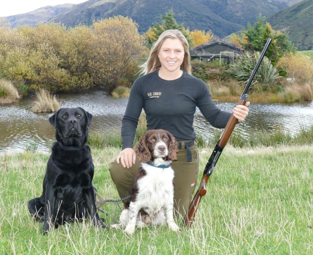Enjoying day one of the duck-shooting season at Kingston is Laura Douglas and her dogs Ash (left)...