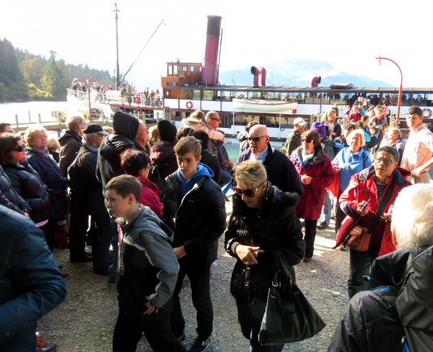Visitors wait to board the ever-popular Earnslaw, as a load disembarks. Photo: ODT