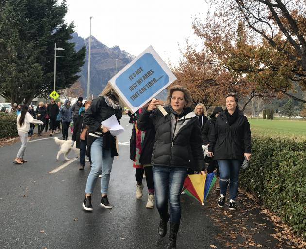 More than 100 teachers, principals and parents are marching in Queenstown. Photo: Daisy Hudson