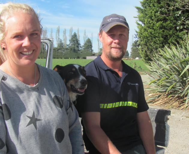 Pencarrow Farm contract milkers Viana and Brad Fallaver with dog Flow, the inspiration behind...